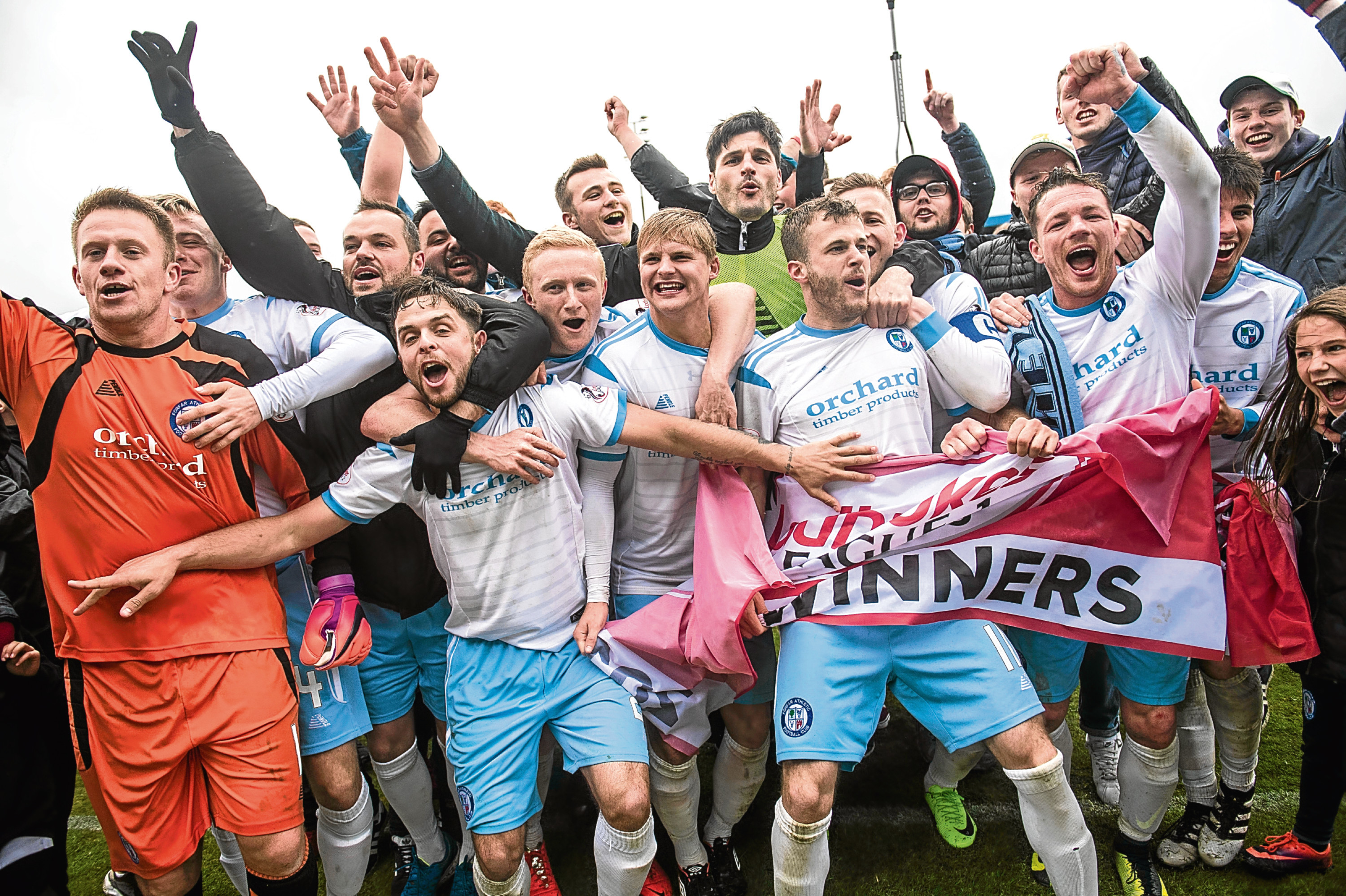Forfar players celebrate promotion to Ladbrokes League 1.