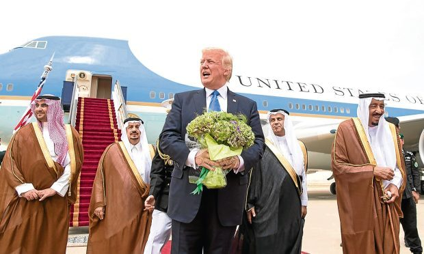 Donald Trump is welcomed to Saudi Arabia by members of the Saudi royal family