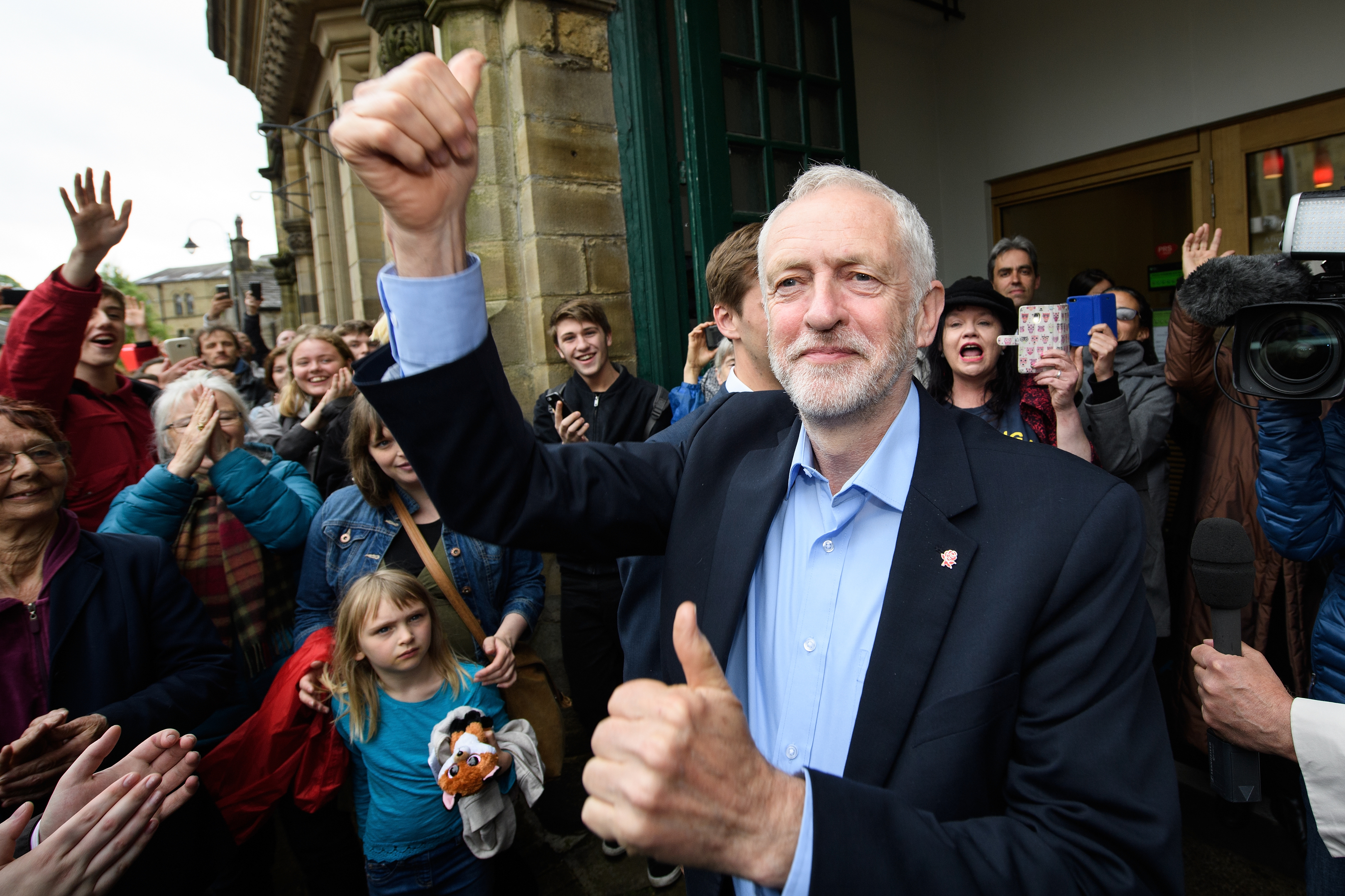 Jeremy Corbyn waves as he arrives before speaking to hundreds of people who attended an election rally on May 15, 2017 in Hebden Bridge.