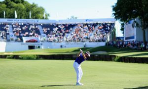 Scott Jamieson hits his third shot on the 18th hole at Wentworth.