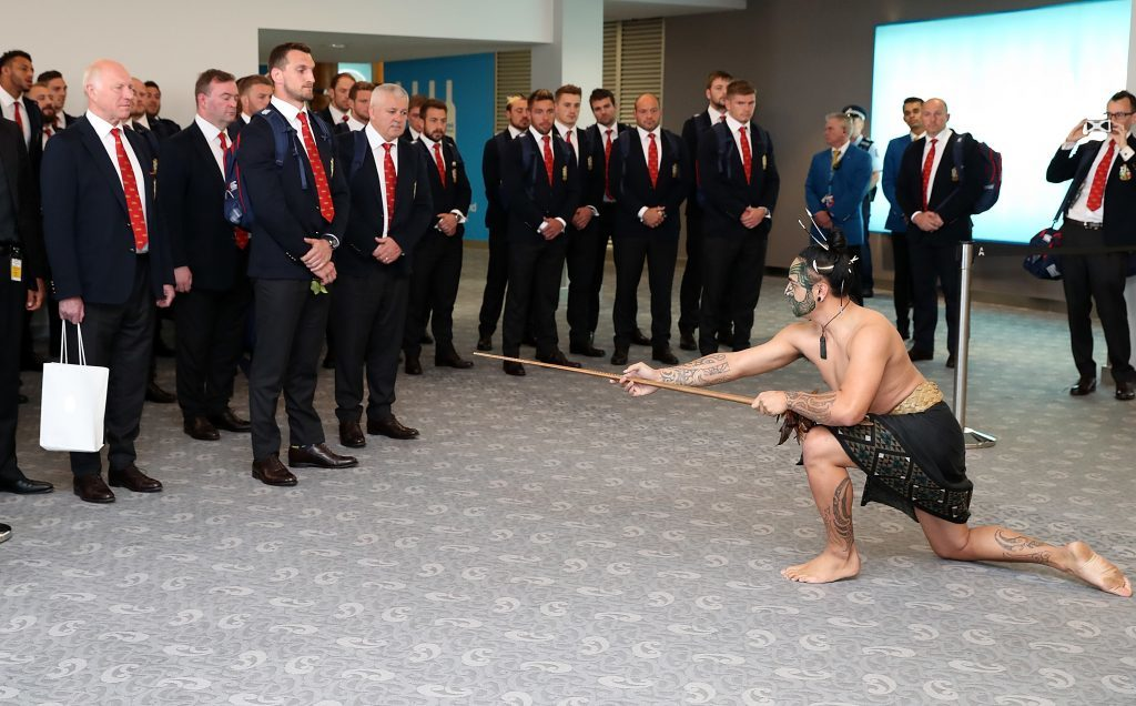 The Lions accept a traditional challenge as part of the welcome as the team arrives at Auckland International Airport.