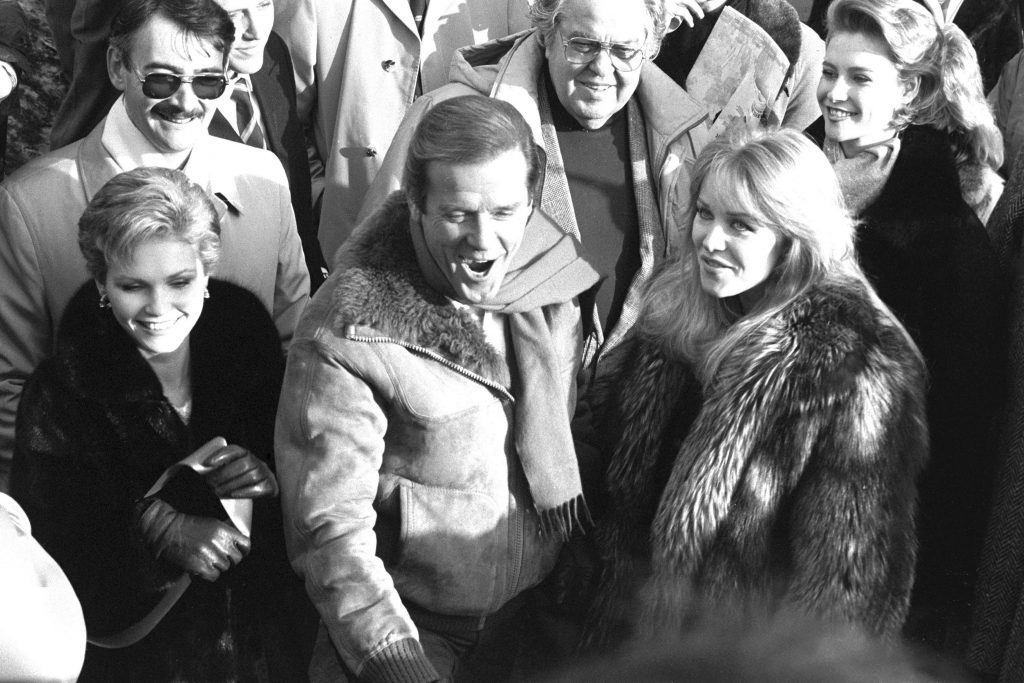 Fiona Fullerton, Sir Roger Moore and Tanya Roberts at the re-opening of the world's largest film stage at Pinewood Studios in 1985, after it was destroyed by a fire.