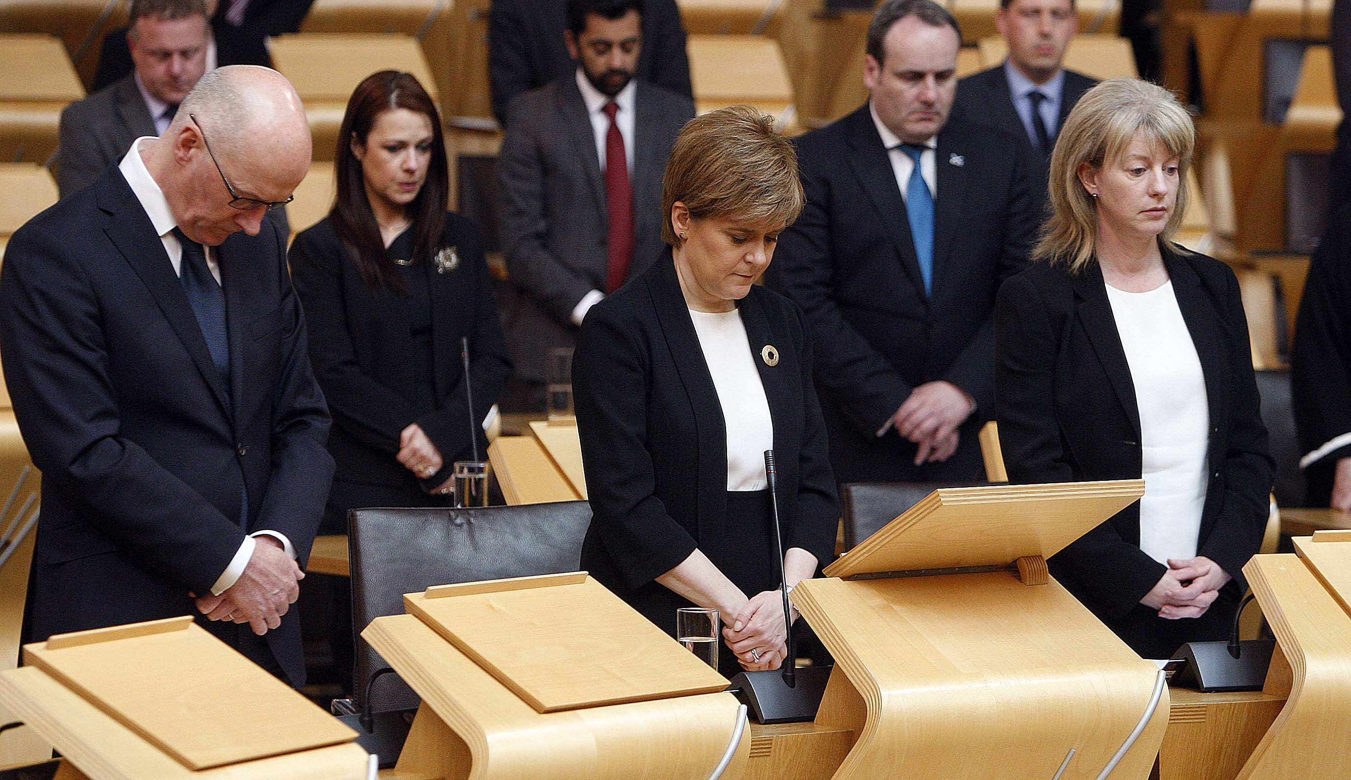 John Swinney, Nicola Sturgeon and Shona Robison during the minute's silence.