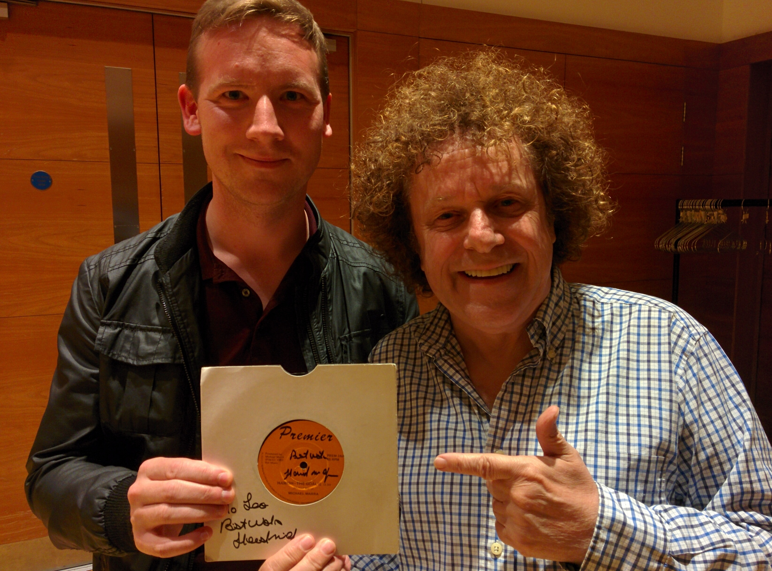 Leo Sayer was presented with the Michael Marra vinyl record by Courier reporter Graeme Strachan before his Perth concert on Saturday.