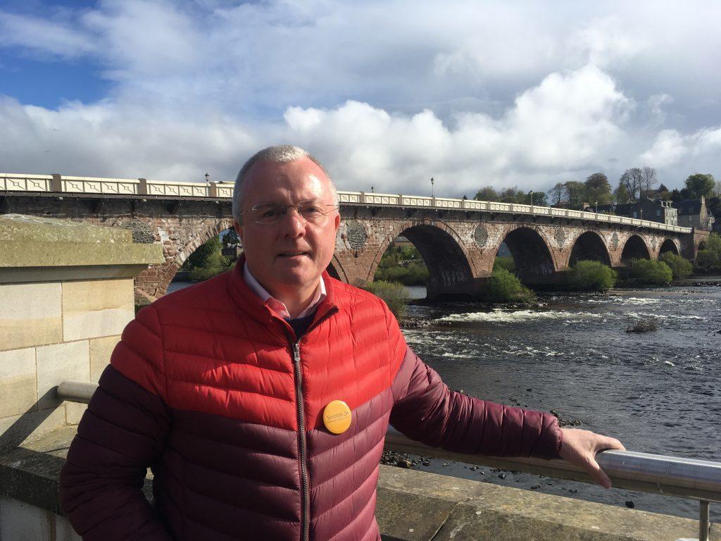 Councillor Peter Barrett beside the Smeaton Bridge.