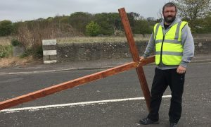 Gordon Cruden with the large cross which is being carried across Scotland