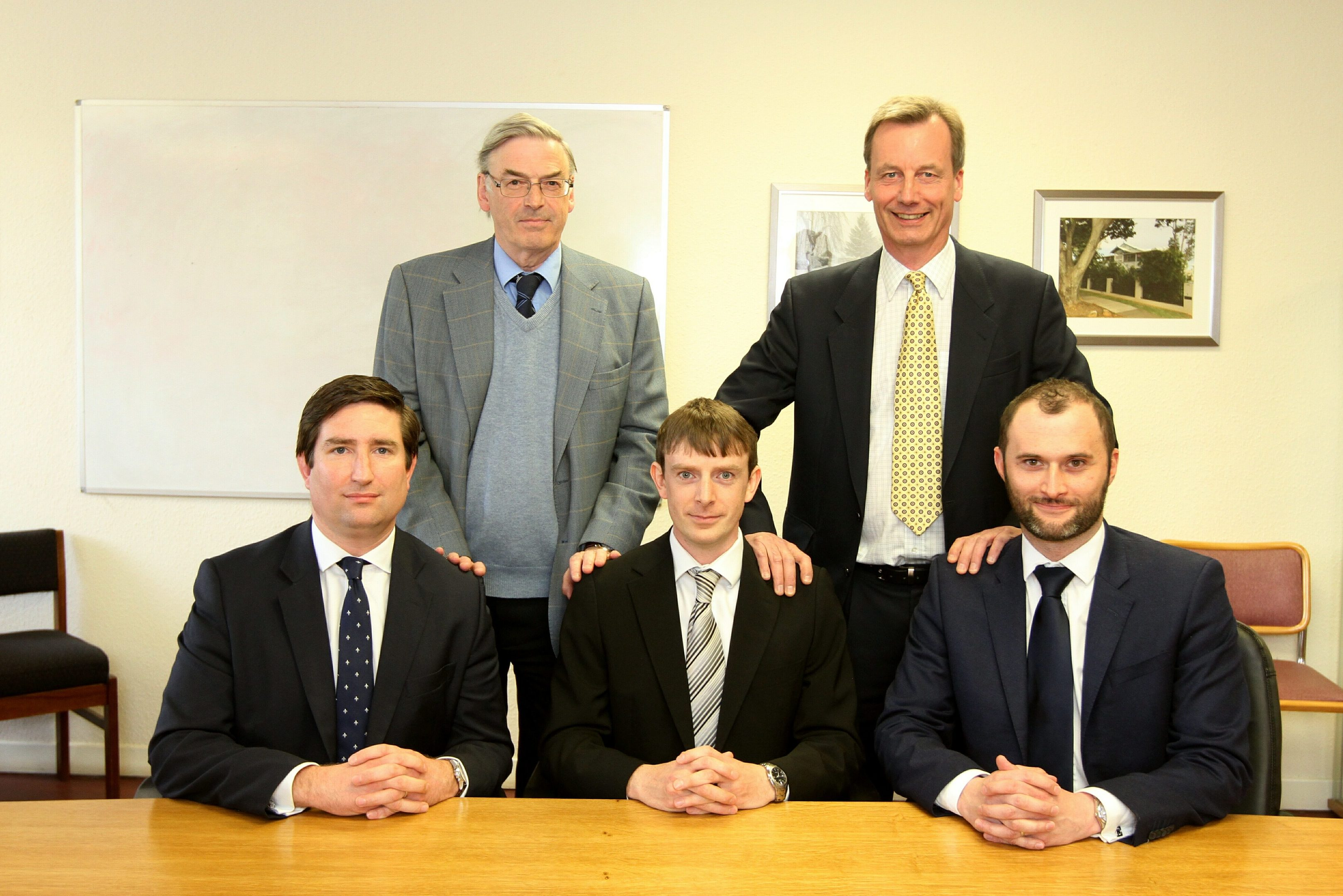 Seated are the new J&D Wilkie board of Roger McGill (Finance Director), Hamish Roweuan (joint Managing Director) and Jean- Christophe Gravier(joint Managing Director), with the old board standing of Mike Rowan and Bob Low.
