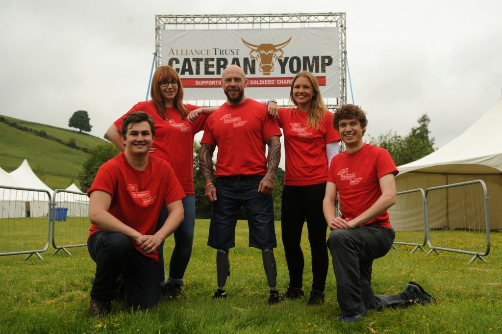 Last year's Yomp ambassador, para-athlete Micky Yule, with supporters.