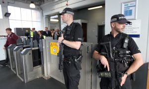 "PICTURED: Armed police on guard at Dundee station as UK terror threat level is lifted to ""critical"""