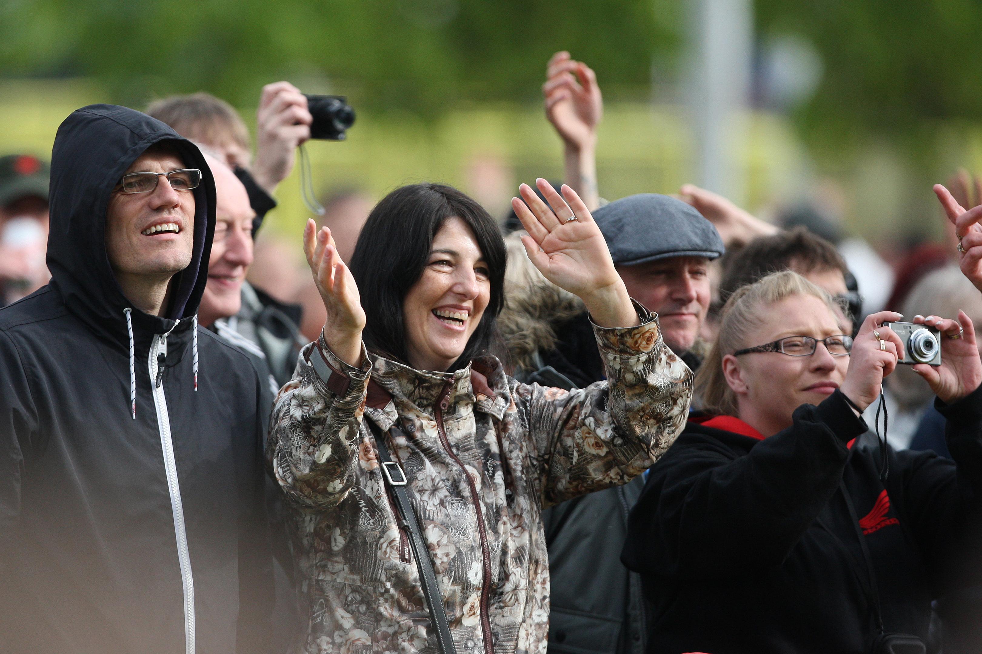 Fans enjoying the show in rain and shine.