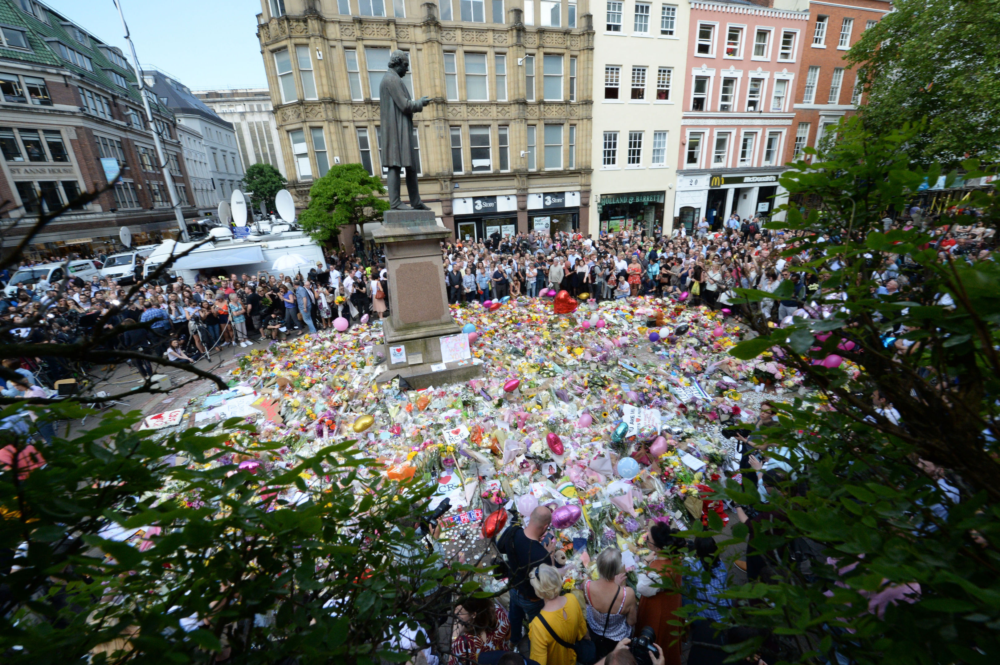 A minute's silence is held in St Ann's Square, Manchester.