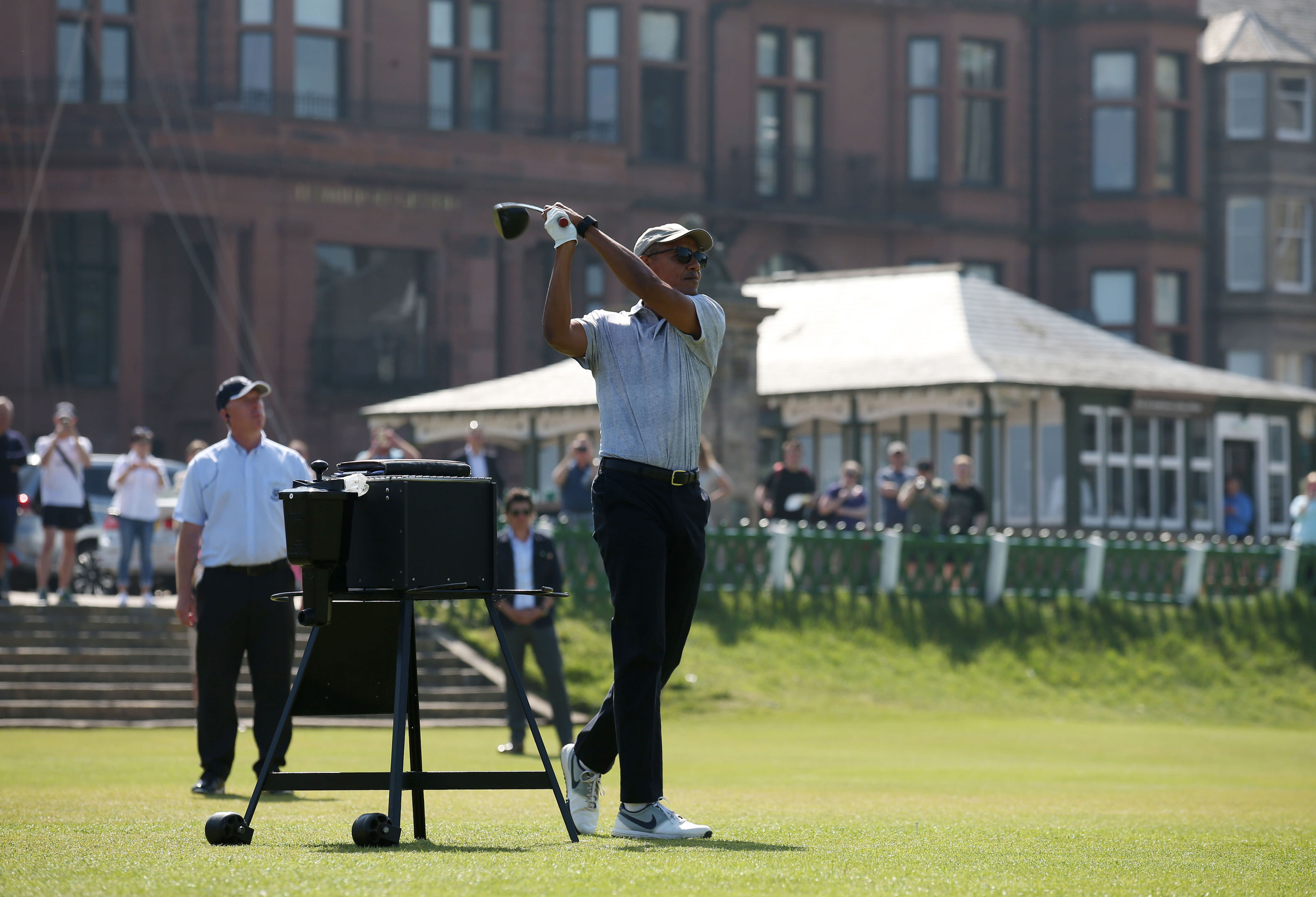 Former US president Barack Obama tees off at the first hole at St Andrews.