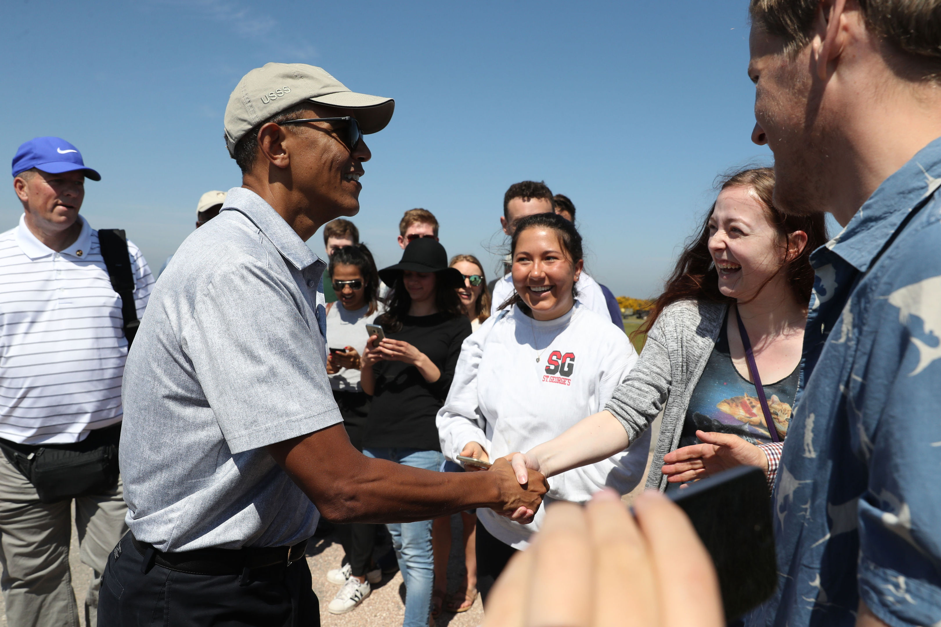 Obama mingles with the St Andrews crowd.