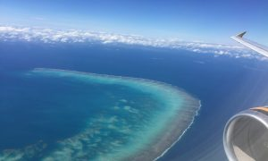 Robin flying into Cairns over the Great Barrier Reef.