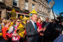 Tim Farron (front) alongside Elizabeth Richies and Sir Menzies Campbell in Market Street, St Andrews.