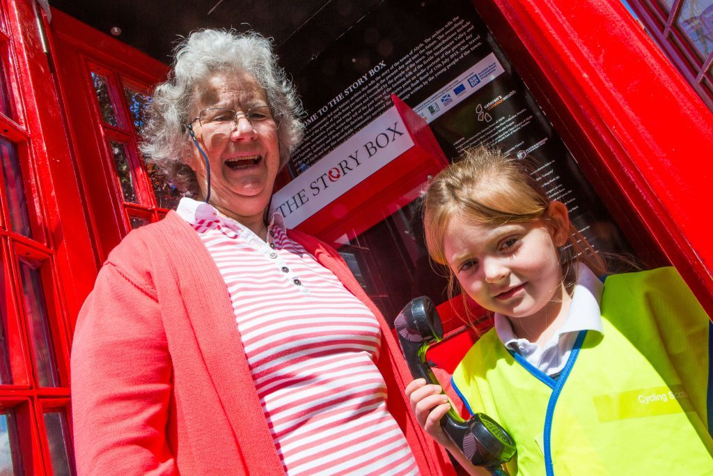 Dorothy Lothian and P1 Pupil Kamryn Burdass officially open The Story Box.