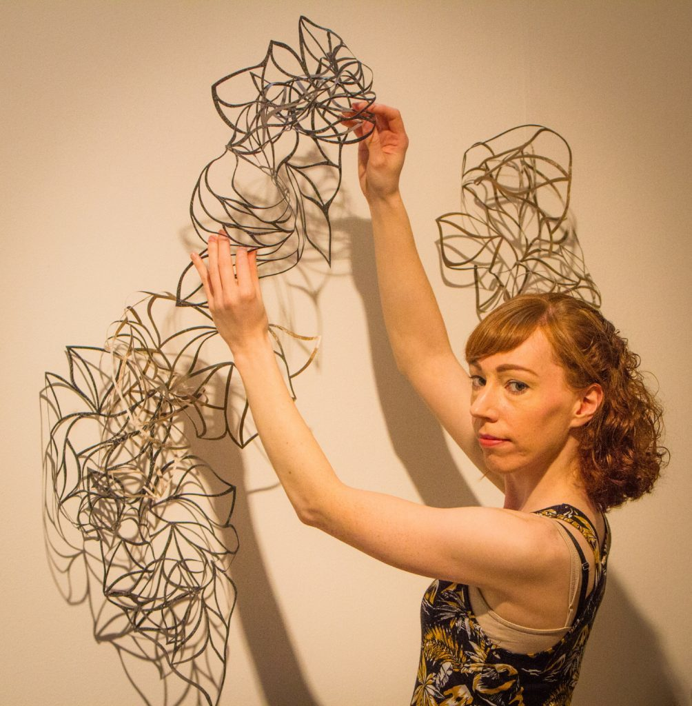 Joanne Hall, 29 with her piece Traces.