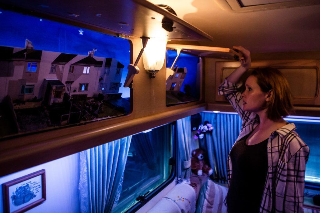 Mobile is set inside a cosy caravan.