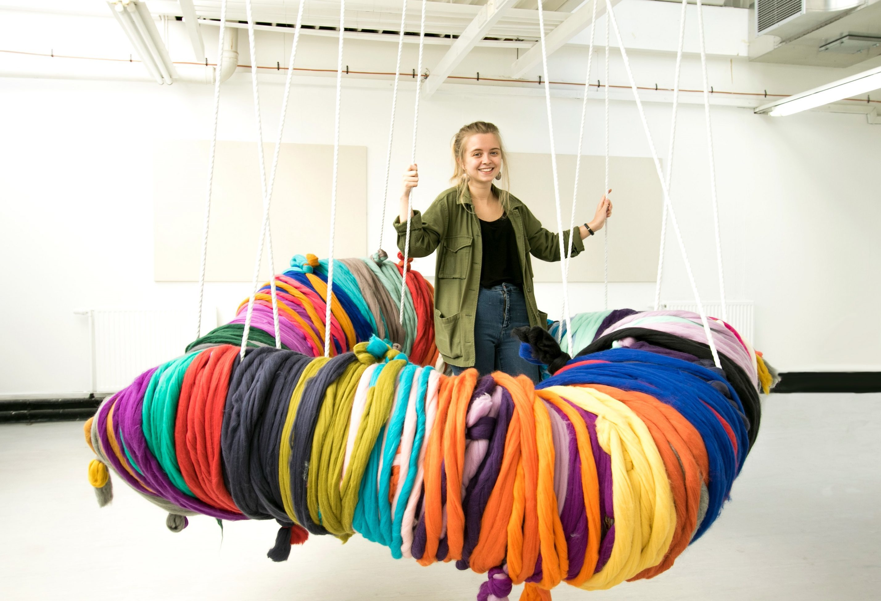 Shannon Murray with her giant pom-pom at this year's Dundee University degree show