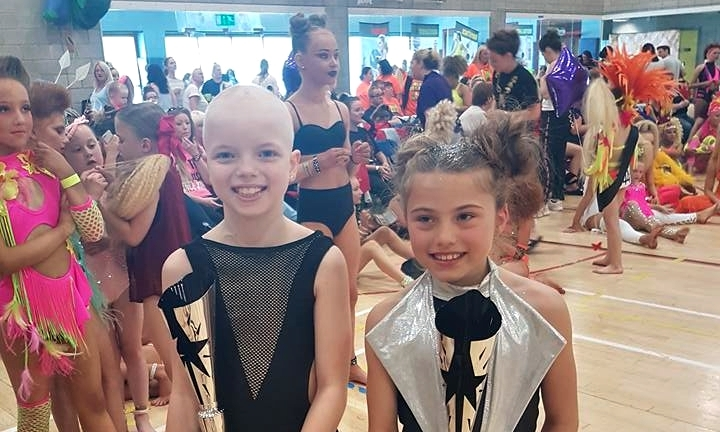 Lily, left, with a fellow dancer at the event.