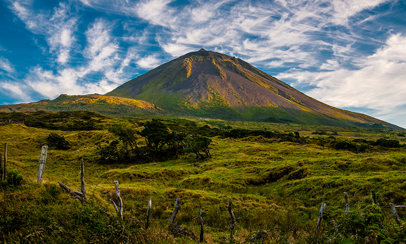 The warm coloured evening sun gracing the volcanic mount Pico on the island of Pico-Azores-Portugal.
