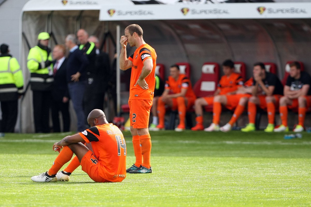 Dundee United players react to the Hamilton loss in the 2017 play-off finals.