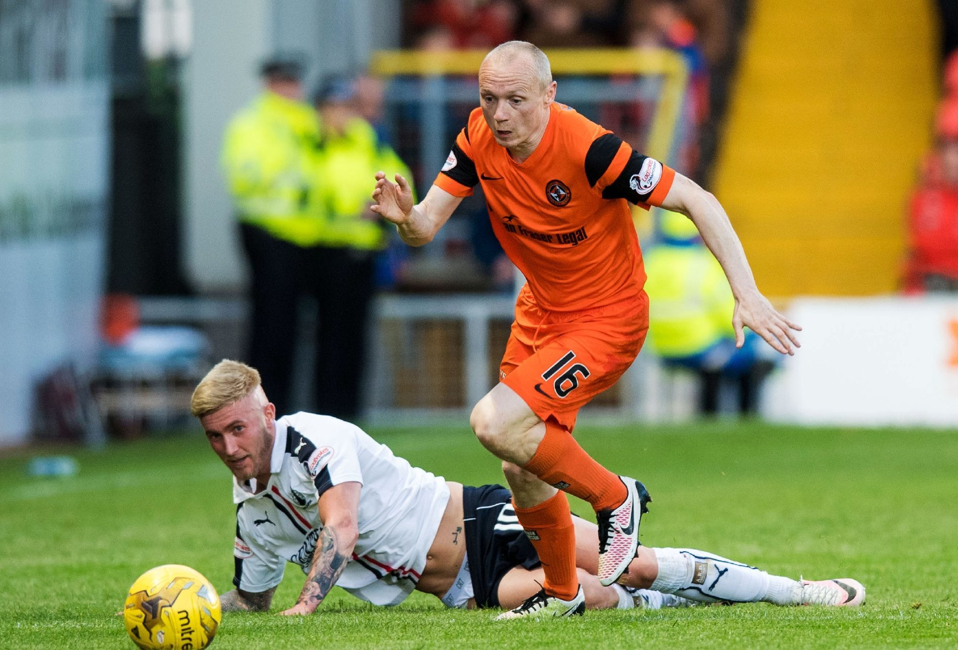 Dundee United's Willo Flood in action with Falkirk's Craig Sibbald.