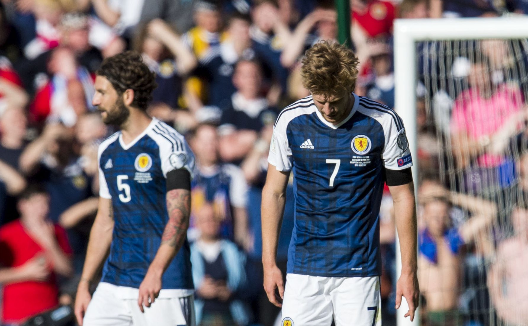 Heads bowed....Scotland after Saturday's football heartbreak.