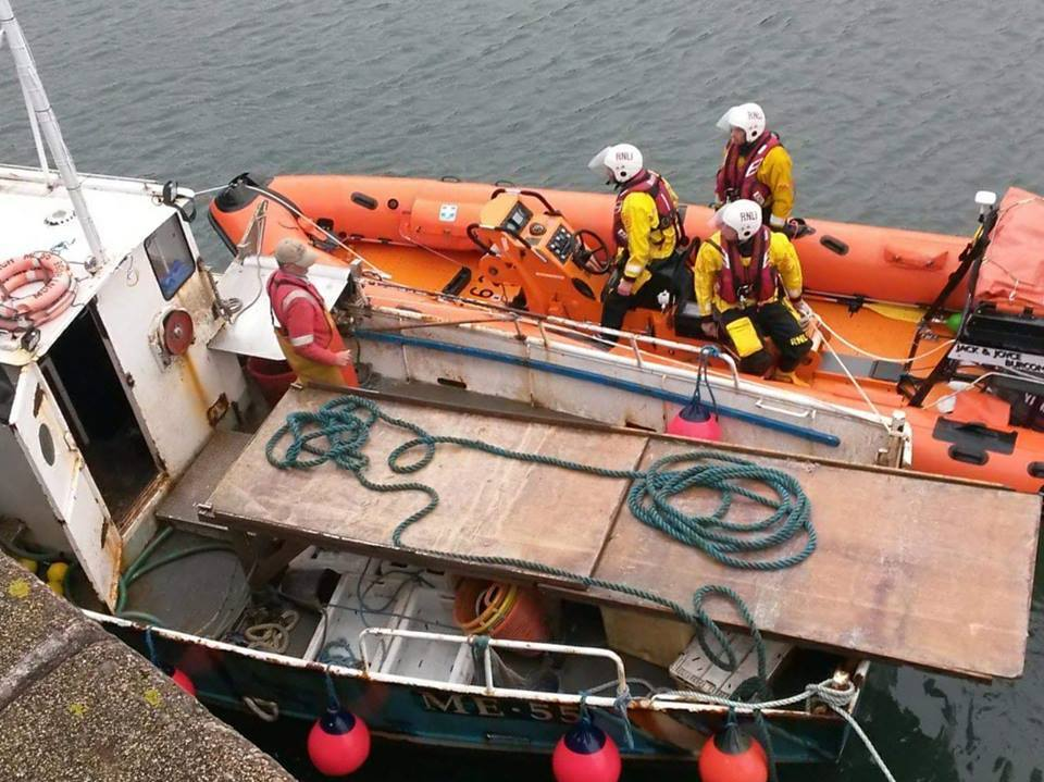 The lifeboat crews assisting the vessel on the Mearns coastline