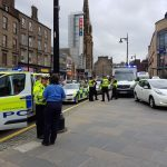 Taxi mounts kerb and knocks over pedestrian in city centre