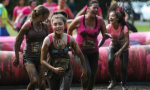 Runners caked in mud during Saturday's Pretty Muddy event.