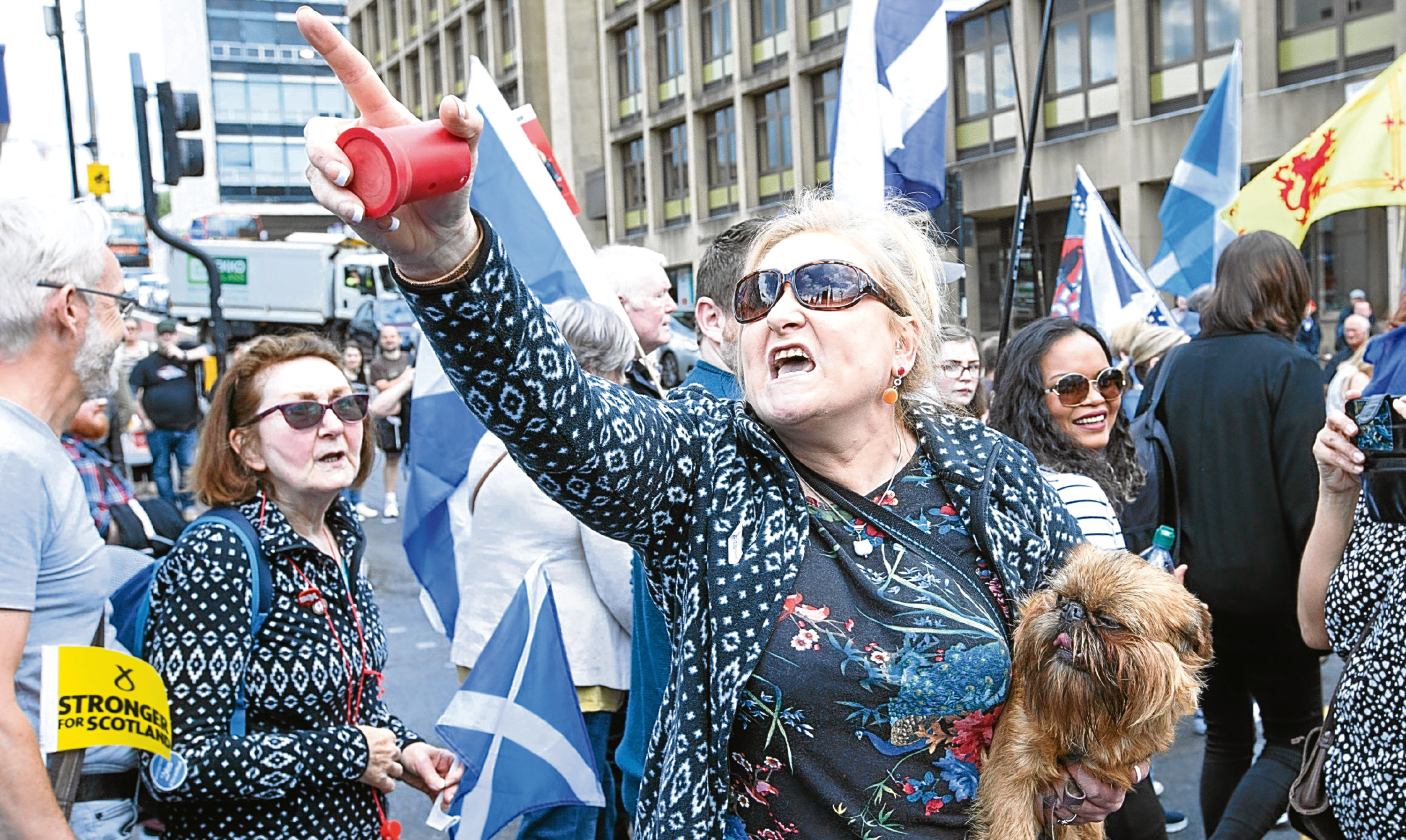 A woman gestures as Saturday's March for Independence is met by counter demonstrators in Glasgow.