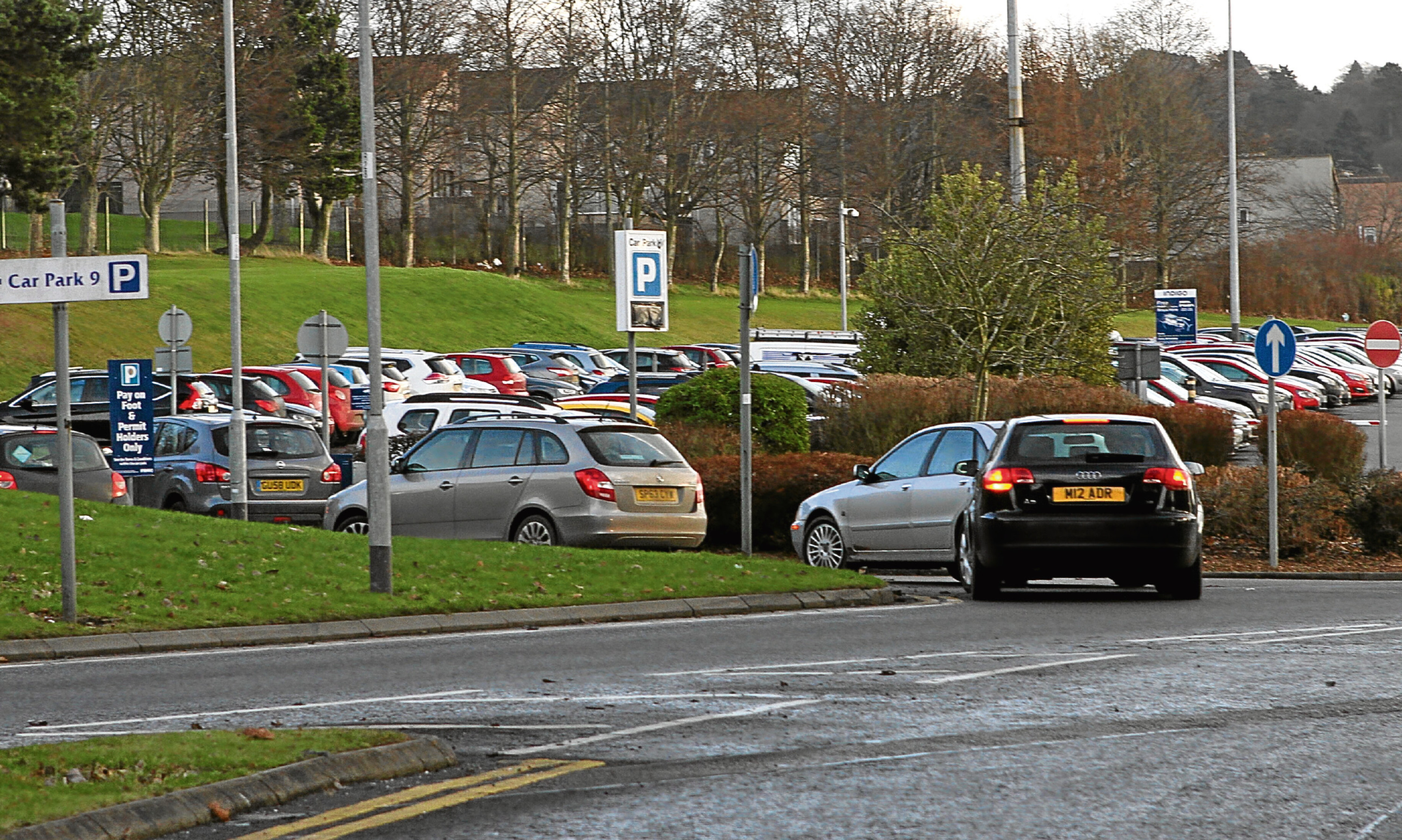 Cars queue to enter car park nine at Ninewells Hospital, Dundee.