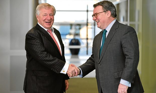 Keith Skeoch, Standard Life CEO, (right) and Martin Gilbert, Aberdeen Asset Management CEO, shake hands after the annoucement of the all share merger in February. They will be joint chiefe executives of the new enlarged firm.