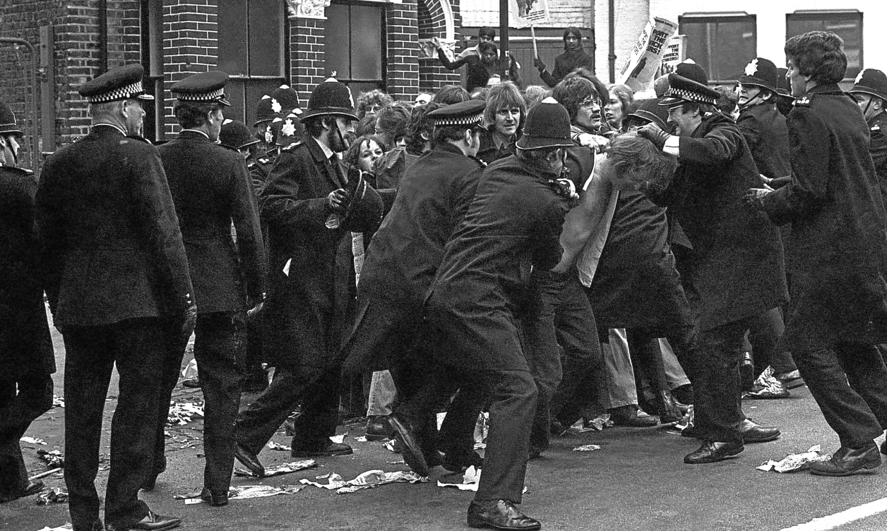 Police restrain pickets at the Grunwick factory in London in June 1977.