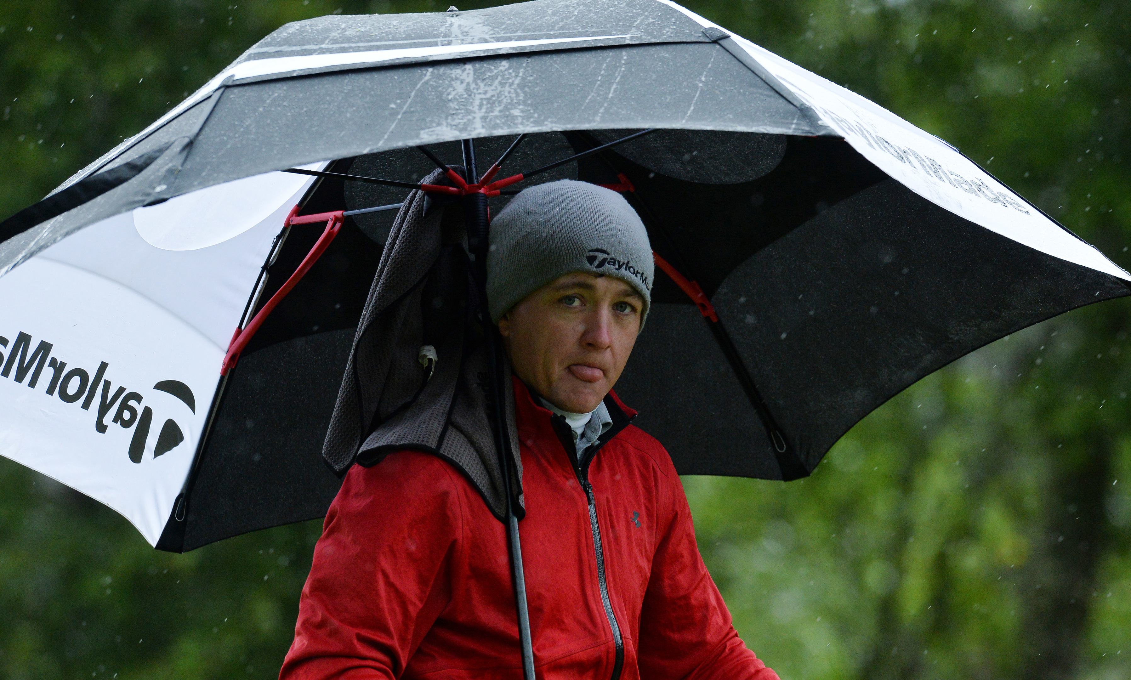 Richard James takes shelter from the wet at Soey Valley on his way to an outstanding 65 in the SSE Scottish Hydro Challenge.