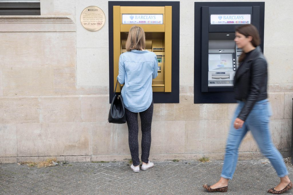 Barclays unveils a gold ATM at its Enfield branch in London to commemorate the 50th anniversary of the worlds first cash machine, installed by the bank at the same site on June 27 1967.
