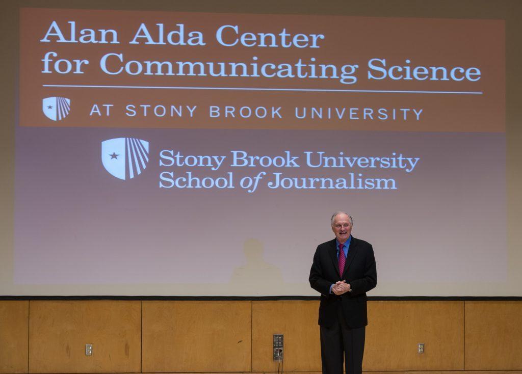 Alan with Alda Center logo