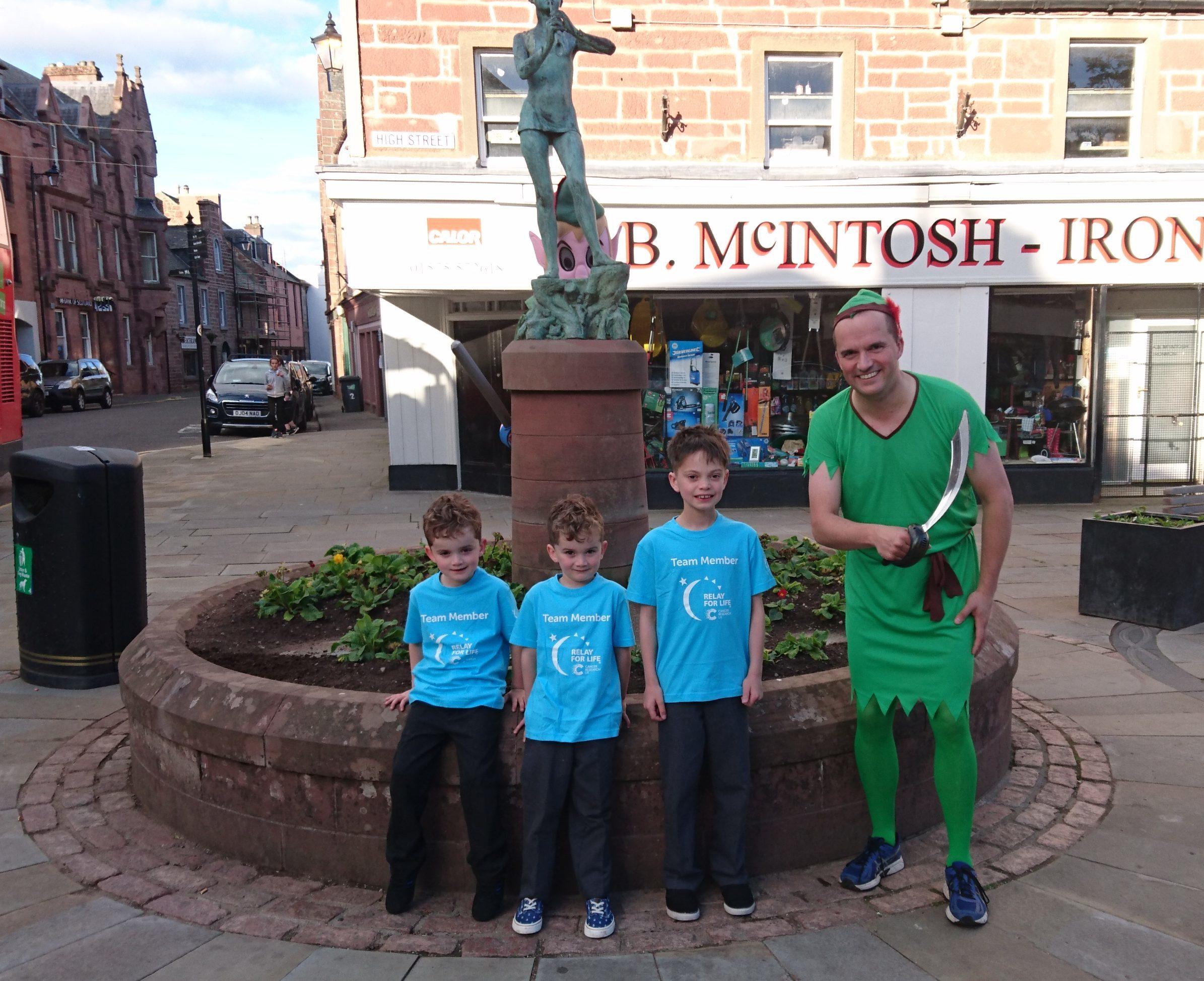 Relay for Life treasurer Scott Kennedy with his children  Gregor 9, Fraser, 6 and Struan, 6.