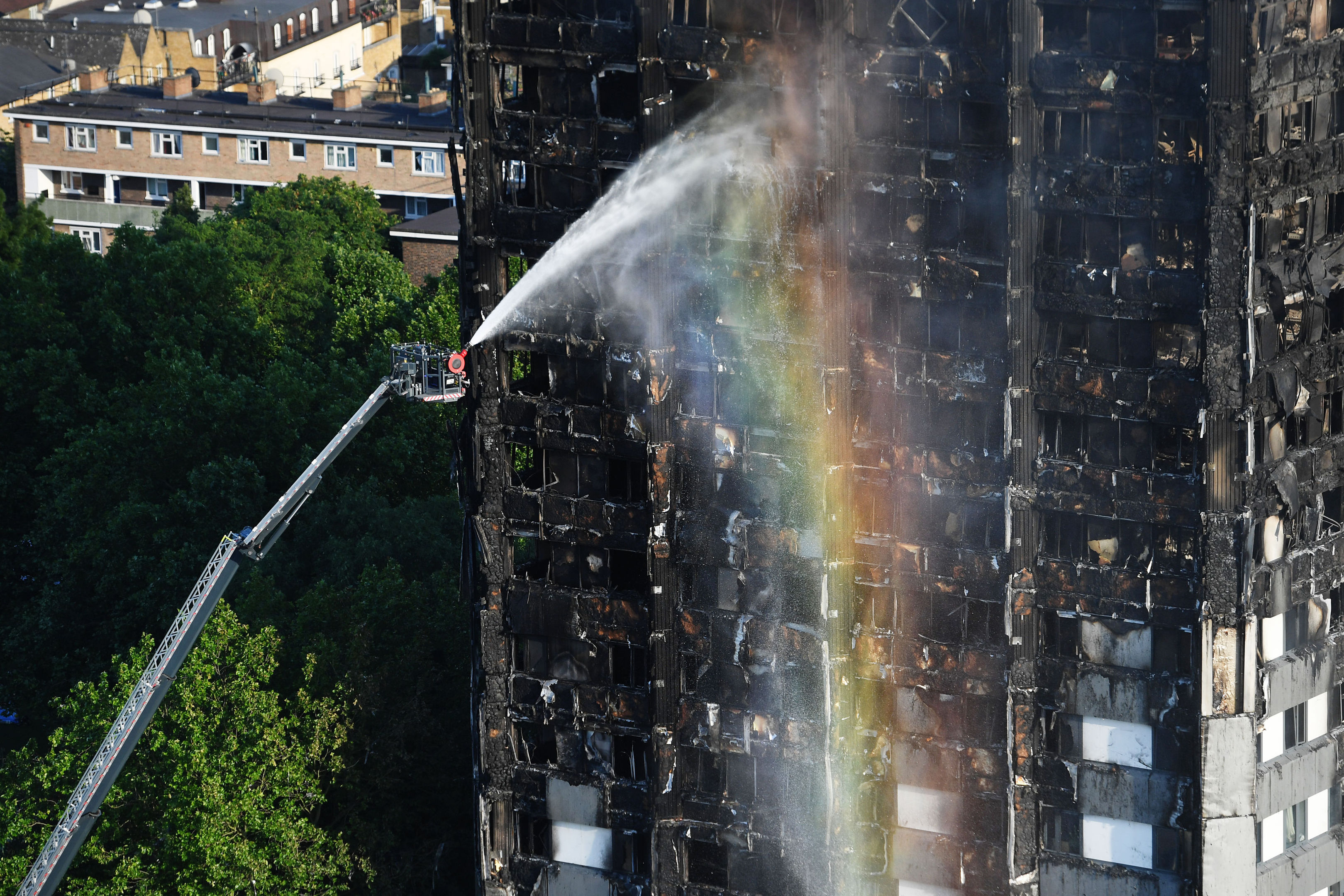Firefighters spray water after a fire engulfed the 24-storey Grenfell Tower in west London.