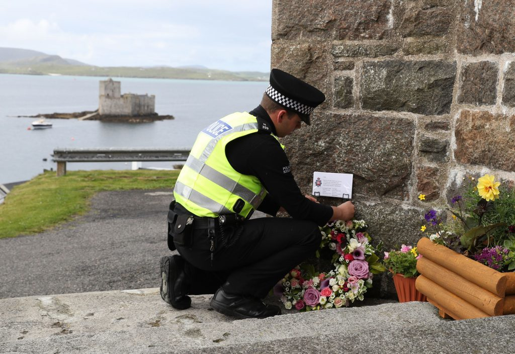 The flowers being laid outside the Church of Our Lady, Star of the Sea, in Castlebay on the island of Barra, ahead of the funeral of Manchester bomb victim Eilidh MacLeod.