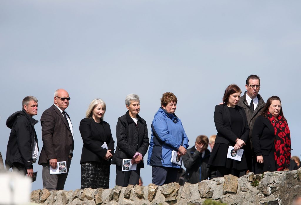 Mourners watch the funeral procession of Manchester bomb victim Eilidh MacLeod on its way to the Church of Our Lady, Star of the Sea, in Castlebay.