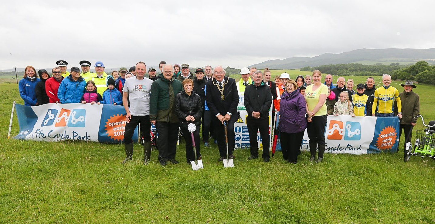 The first sod is cut by Provost Jim Leishman and Councillor Judy Hamilton.