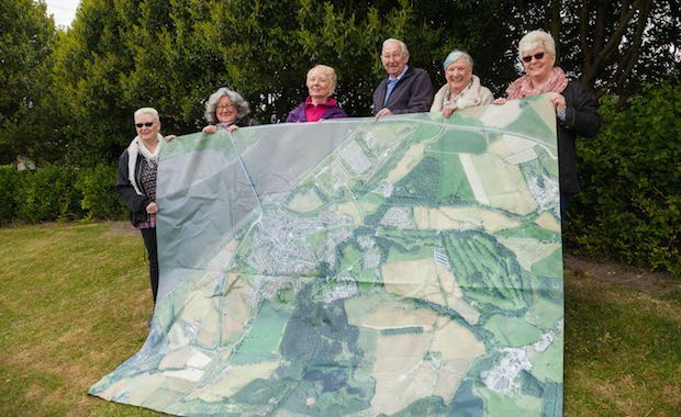 Pauline Douglas, Janice McLaughlin, Lesley Gavin, Willie Anderson, Mary Harley and Enid Trevett hold up a map of Kincardine.