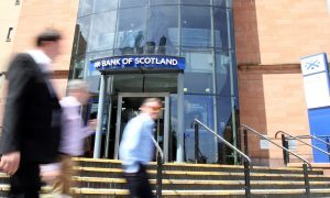 People passing by the Lloyds Bank of Scotland premises in Dundee.