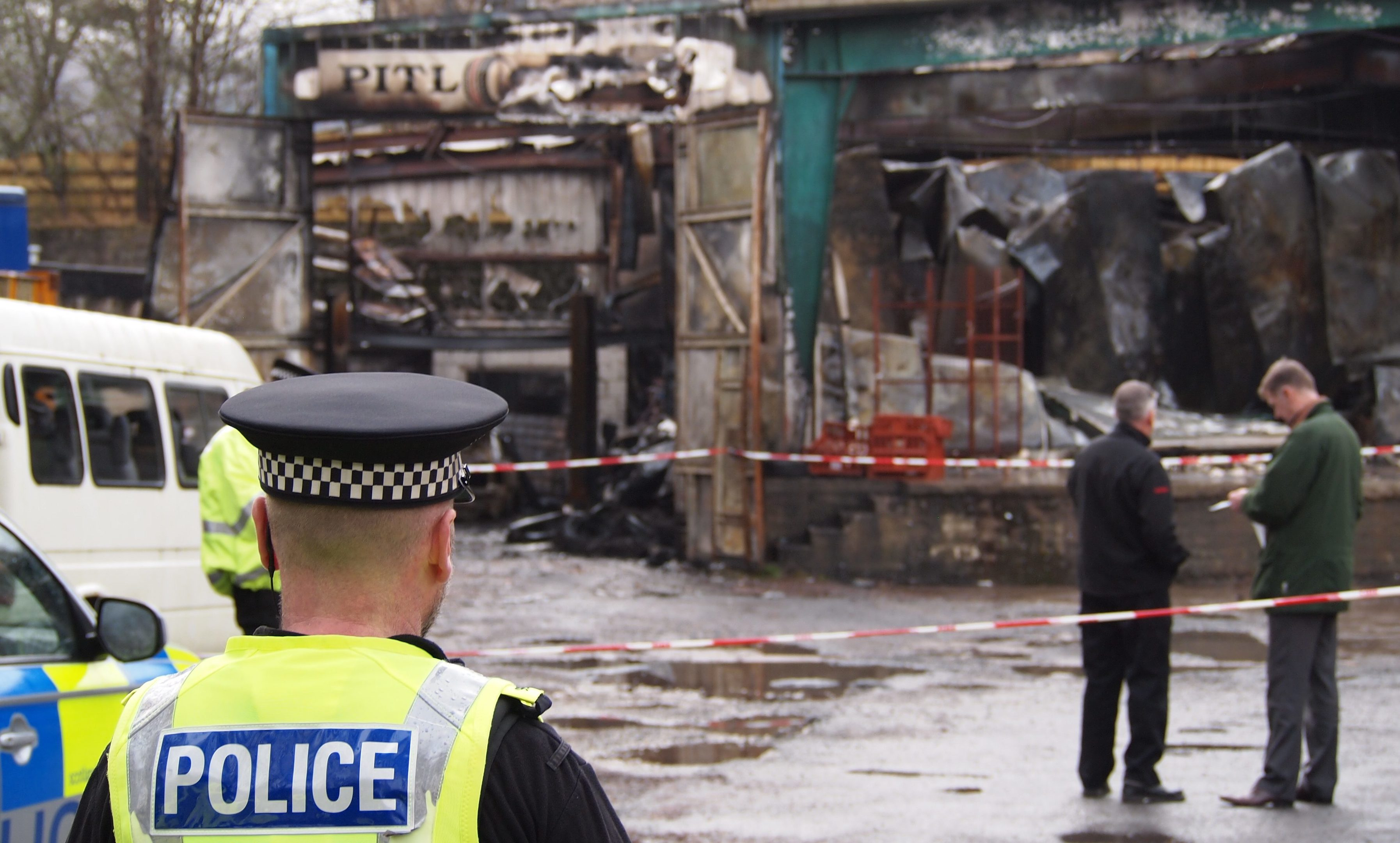 Police probe the blaze at the Hubertus game factory in January 2016.