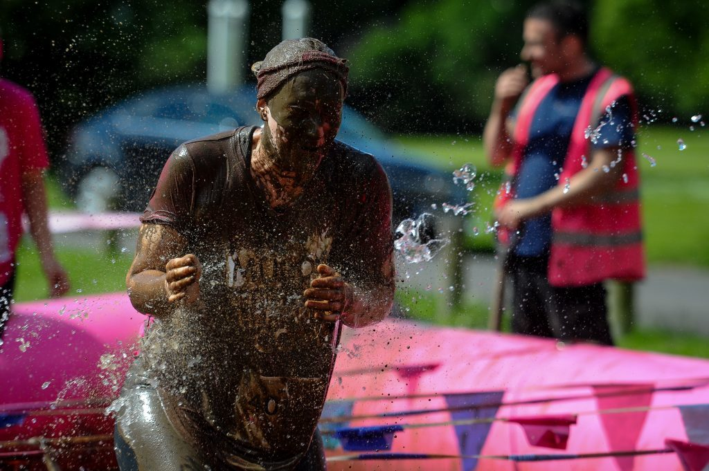 A very muddy competitors at the, Race for Life charity fundraiser for cancer research.