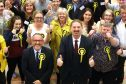Stewart Hosie and Chris Law celebrate with SNP supporters.