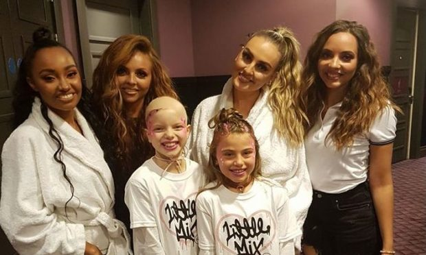 Lily Douglas with her friend Cerys Robertson and Little Mix.
