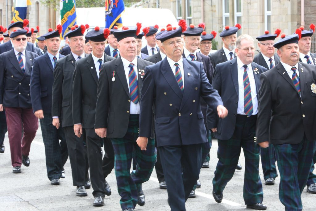 Black Watch veterans march to Balhousie Castle in Perth after watching the unveiling.